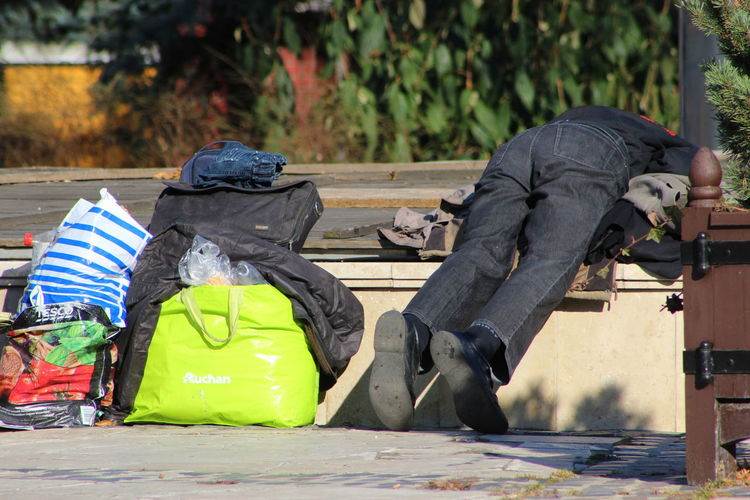 Sleeping on a covered fountain. First sunny day. Asked him, he was OK. Just taking a nap - not freezing, finally. Day First Sunny Day Homeless Lying Nap Outdoors People Sad Spring Top Of A Fountain Weird
