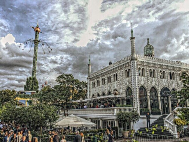 Copenhagen, Denmark Tivoli Garden Tivoli Scenery HDR Effect Dramatic Sky Dramatic Skies Dramatic Scene Many People Funfare Detail Funfare Place Very Old Amusement Park Architecture Built Structure Outdoors People Have Fun People Watching People Together People Of EyeEm Week On Eyeem Effects & Filters Travel Destinations Nimb Building Architecture Real People