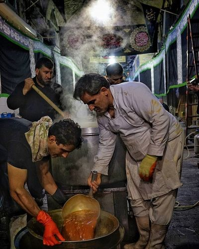 A staff of volunteers cook up food for the less fortunate at the Grand Bazaar in Tehran The occasion was the annual Ashura holiday. It's a day, or actually a series of days, of mourning. Iran Iran4real Everydayiran