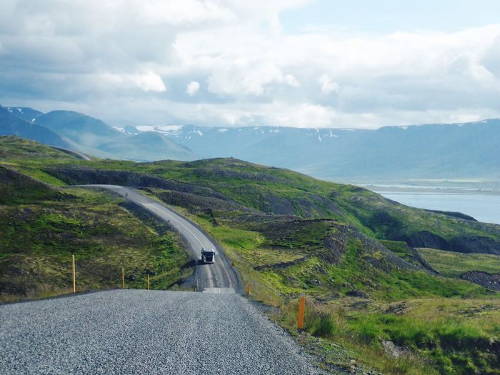 Roadtrip in Iceland Landscape Devoid Of People Roadside Scenery Northern Fjords Rundreise Island Lorry On A Secluded Track Truck On A Secluded Road Iceland Roadtrip Road Mountain Day Nature Beauty In Nature Outdoors Sky Scenery The Way Forward Winding Road Landscape Transportation