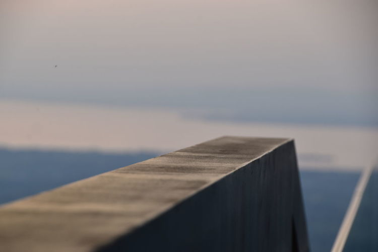 Close-up of pier over sea against sky