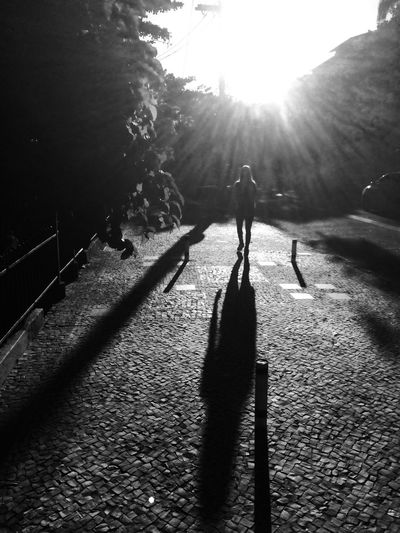 Shadow of people on sunny day