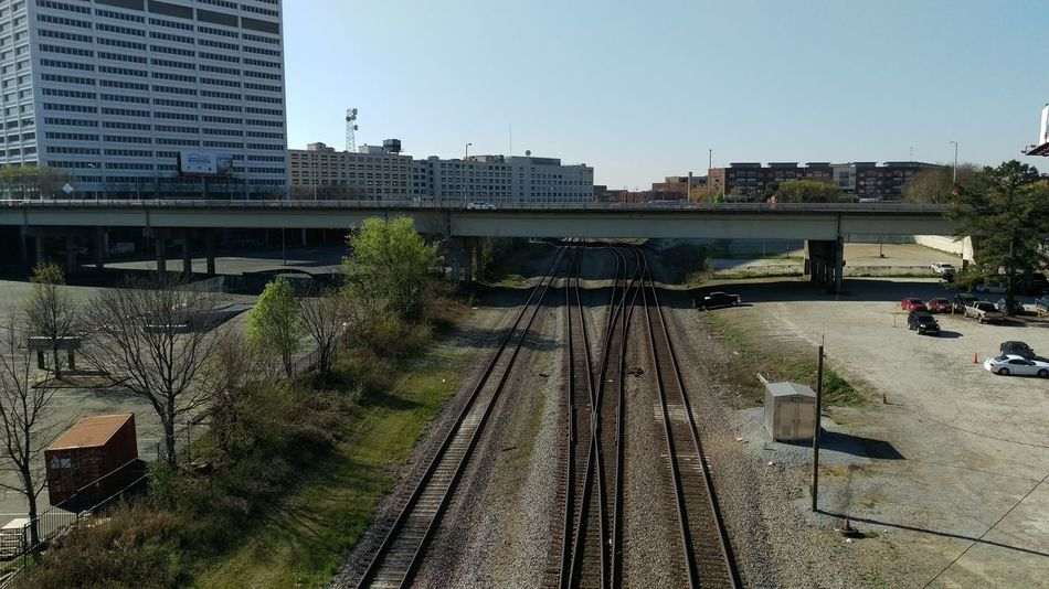 Architecture Built Structure City City Life Day Diminishing Perspective No People Outdoors Public Transportation Railroad Track Railway Track Sky The Way Forward Vanishing Point