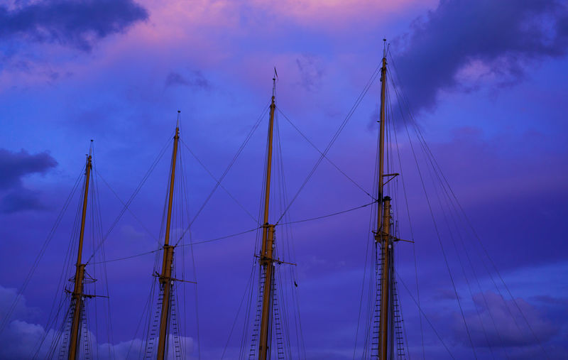 Low angle view of sailboat against sky at sunset