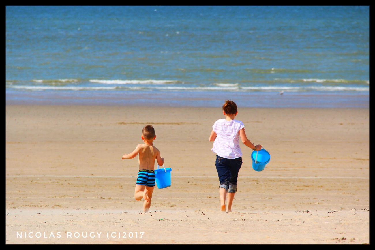 Beach Sea Sand Vacations Childhood Child Full Length Summer Shirtless Boys Leisure Activity Two People Day Girls Outdoors Nature Fun Wave Togetherness Travel Destinations