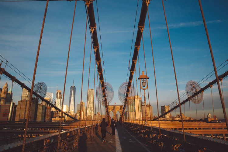 Adult Adults Only Architecture Bridge - Man Made Structure Brooklyn Bridge  Brooklyn Bridge / New York Cloud - Sky Connection Day Large Group Of People Light Morning New York New York City Outdoors People Sky Sunrise Suspension Bridge Transportation Winter