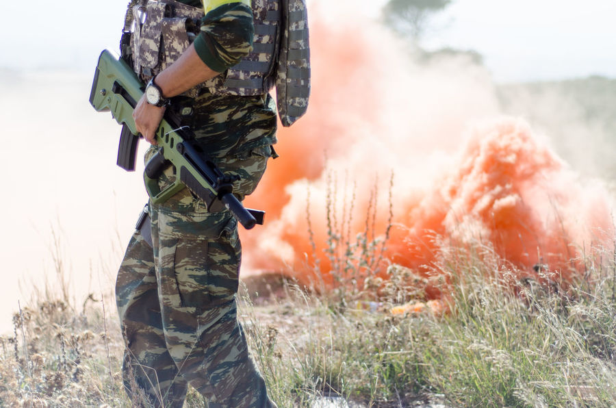 Special forces training Airsoft AiRSOFTGUN Army Army Life Army Soldier Camouflage Clothing Close-up Hand Gun Men Military Uniform One Man Only One Person Only Men Outdoors People Red Smoke Rifle Smoke Grenade Special Forces Standing Uniform Watch