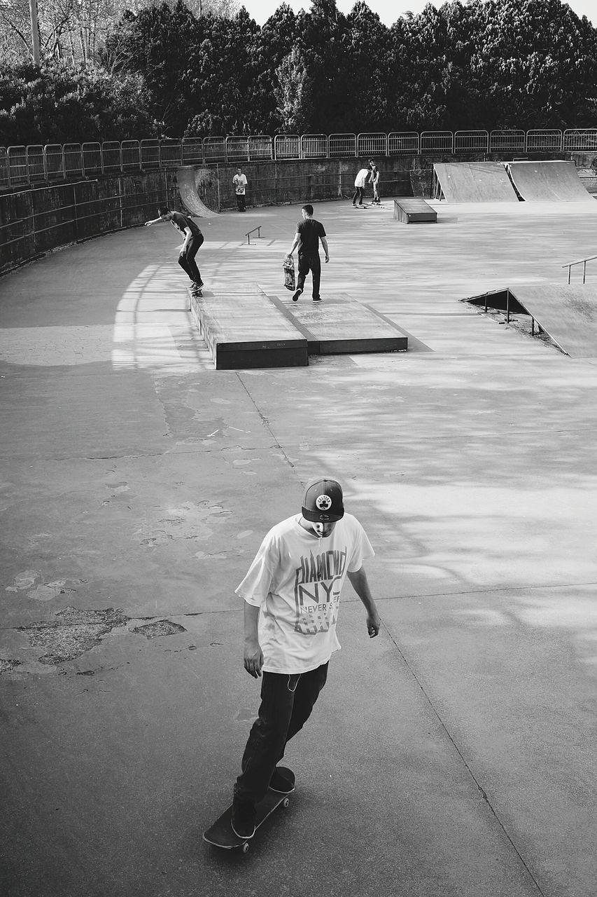 Elevated View Of Three Teenage Skateboarders