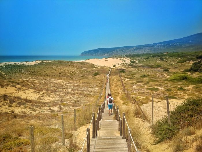 The Way Forward Footpath Outdoors Walking Adventure Sand Vacations Beauty In Nature Full Length Landscape Nature Travel Destinations Day People Clear Sky Scenics Sand Dune One Person Sky Adult
