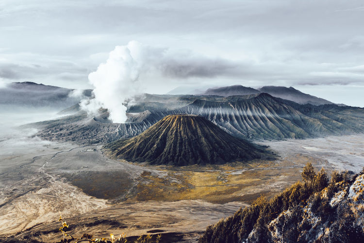 Panoramic view of volcanic landscape against cloudy sky