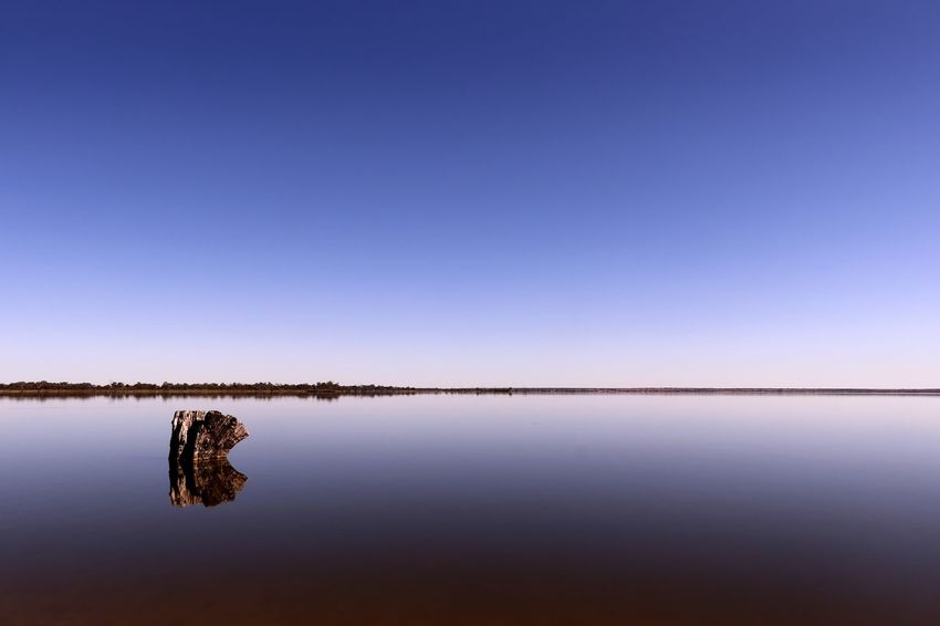 A calmness presides over Lake Bonney at Barmera in the riverland of South Australia Australian Landscape Calm Travel Travel Photography Beauty In Nature Blue Clear Sky Day Lake Lake Bonney Landscape Nature No People Outdoors Reflection Scenics Sky Still Water Sunset Tourist Destination Tranquil Scene Tranquility Travel Destination Water