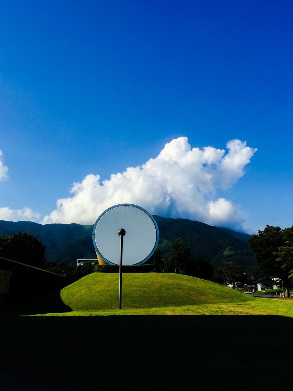 Sculpture On Grass At Nagi Museum Of Contemporary Art Against Sky