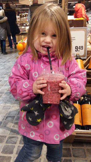 Tottler enjoying healthy smoothie Casual Clothing Child Childhood Drink Drinking Drinking Straw Females Food Food And Drink Front View Girls Glass Healthy Kid Healthy Smoothie Holding Innocence One Person Outdoors Pink Color Refreshment Standing Straw Three Quarter Length Women