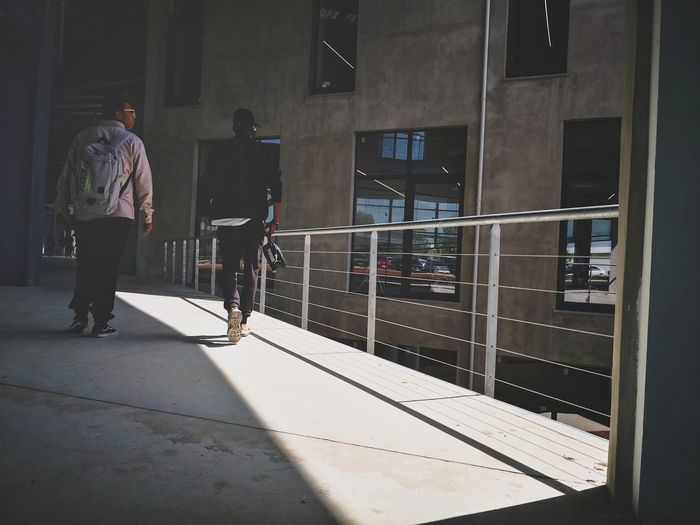 EyeEm Selects Pastel Power Walking Around Streetphotography Great Atmosphere Urbanphotography Smartphonephotography WeekOnEyeEm Dim Light Architecture Light And Shadow Having Fun Wall - Building Feature Shadows & Lights Politics And Government Prison Men Full Length Walking Politics Standing Lock Entryway