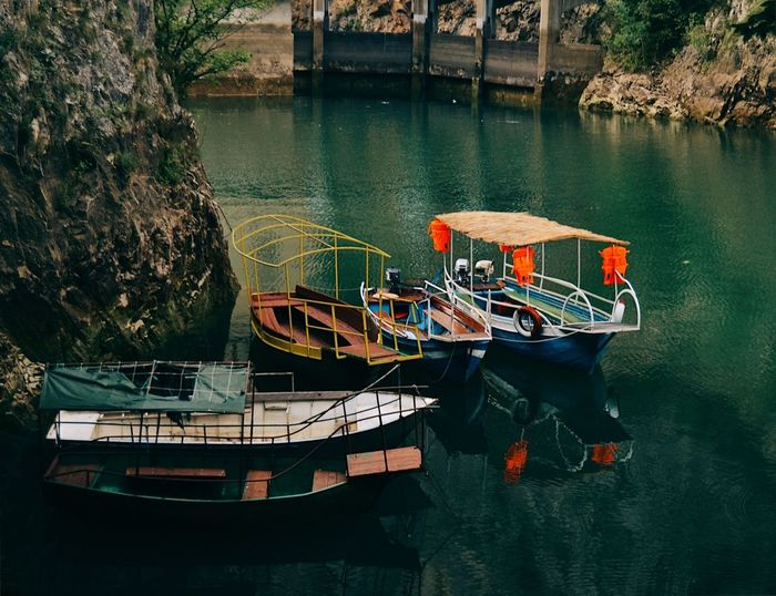 Canyon Matka Matka Canyon Matka Macedonia Water Nautical Vessel Moored Mode Of Transportation Transportation No People Nature High Angle View Architecture Lake Day Building Exterior Built Structure Plant Outdoors Fishing Boat Rowboat Reflection Sunlight Waterfront