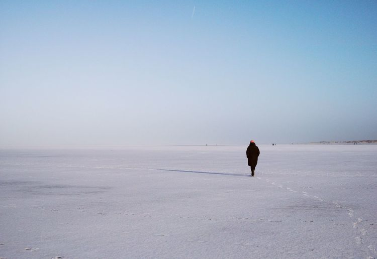Sankt Peter ording An Eye For Travel Landscape_Collection Nature Photography Shades Of Winter Tranquility Beauty In Nature Clear Sky Cold Temperature Copy Space Full Length Landscape Landscape_photography Minimal Minimalism Nature One Person Outdoor Photography Outdoors Scenics Snow Walking Warm Clothing Winter Love Yourself Colour Your Horizn Colour Your Horizn #FREIHEITBERLIN The Great Outdoors - 2018 EyeEm Awards The Minimalist - 2019 EyeEm Awards