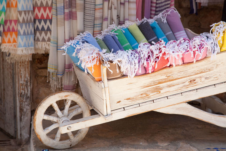 Close-up of textile in cart for sale at market