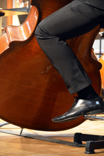 Arts Culture And Entertainment Chair Classical Music Close-up Concert Doublebass Jazz Low Section Music Musical Instrument Musician One Person Shoe