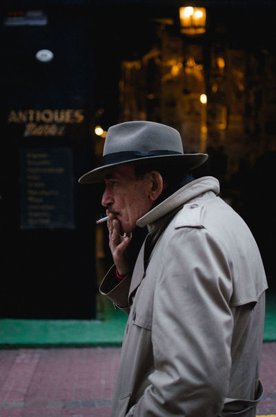 Smoking guy, San Telmo, Buenos Aires. Real People One Person Hat Men Night Clothing Standing Side View Waist Up Males  Illuminated Adult Lifestyles Architecture Cap Casual Clothing Leisure Activity Focus On Foreground Profile View Smoking EyeEm Best Shots EyeEm Selects Streetphotography
