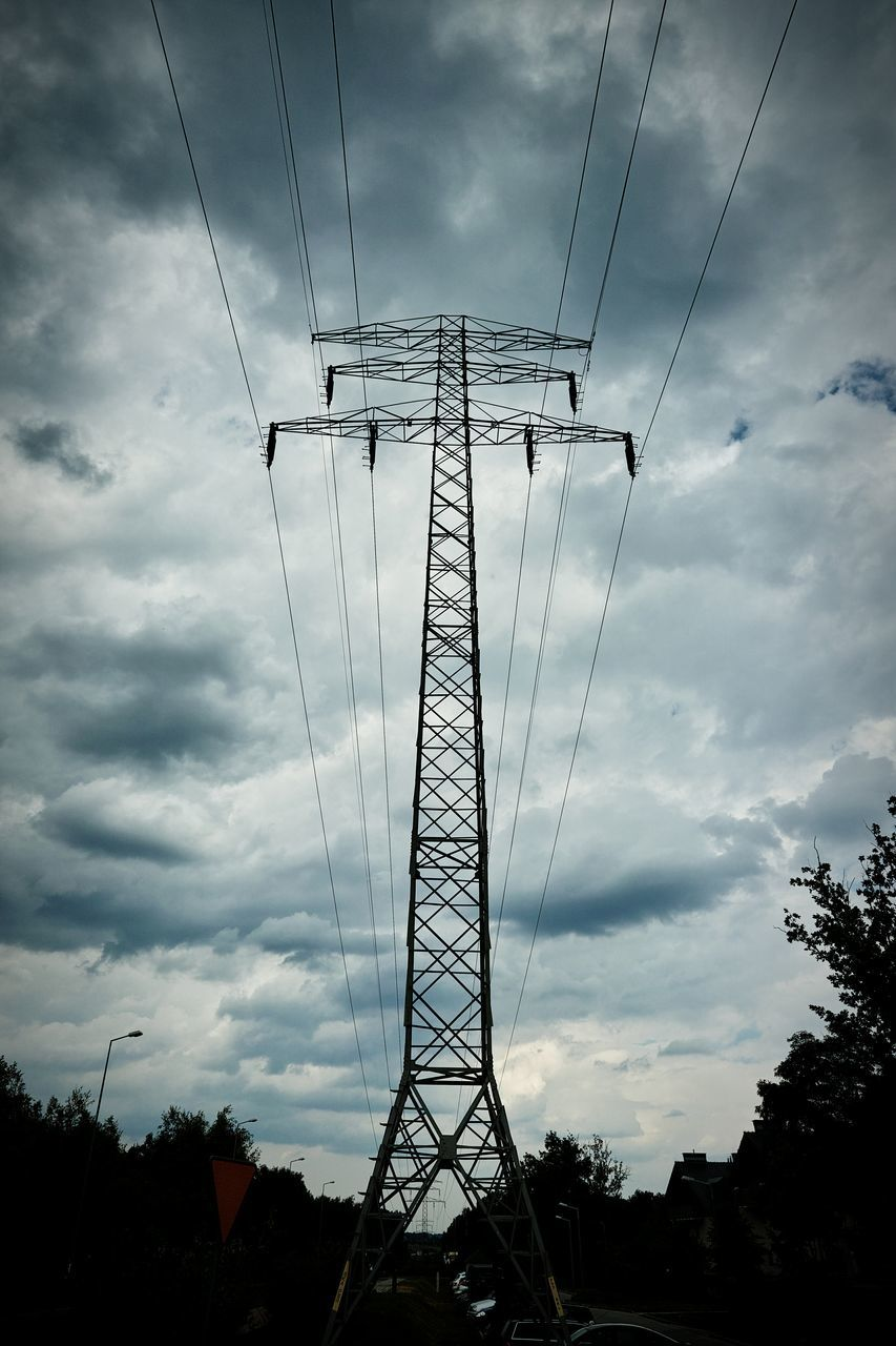 cable, sky, cloud - sky, electricity, low angle view, electricity pylon, connection, power line, power supply, fuel and power generation, tree, technology, day, no people, silhouette, outdoors, nature
