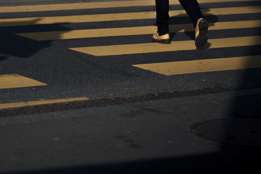 Street Photography series: a perfect match City Life Crossing Human Body Part Human Leg Low Section Outdoors Pedestrian Road Shadow Street Street Photography Streetphotography Walking Yellow Zebra Crossing The Street Photographer - 2017 EyeEm Awards Paint The Town Yellow