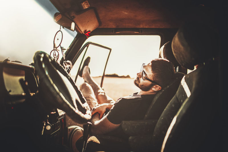 Adult Car Casual Clothing Day Glasses Land Vehicle Leisure Activity Lifestyles Males  Men Mode Of Transportation Motor Vehicle One Person Outdoors Real People Side View Sitting Transportation Vehicle Interior Young Adult This Is My Skin EyeEmNewHere #FREIHEITBERLIN