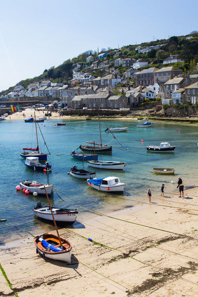 A view of the Cornish fishing village of Mousehole with its small harbour full of traditional British sailing and fishing boats and rows of old, stone cottages in Cornwall, UK. Mousehole Mousehole, Cornwall Harbour Fishing Boats Sailing Cottages England Uk Cornwall Cornwall Uk Cornwall Walks Cornish Coast Seaside Vacation Travel Travel Destinations Holiday Landscape Picturesque Fishing Village Traditional Village Coast Coastal_collection Britain