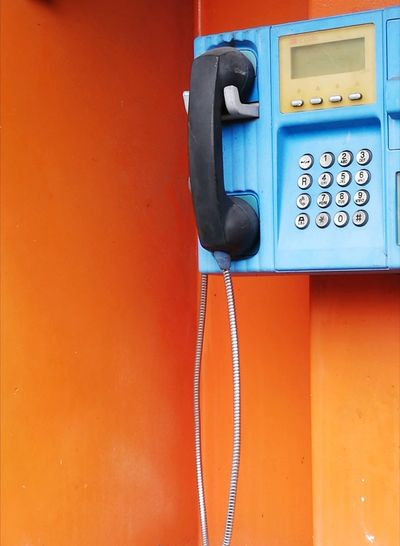 Close-up of payphone in telephone booth