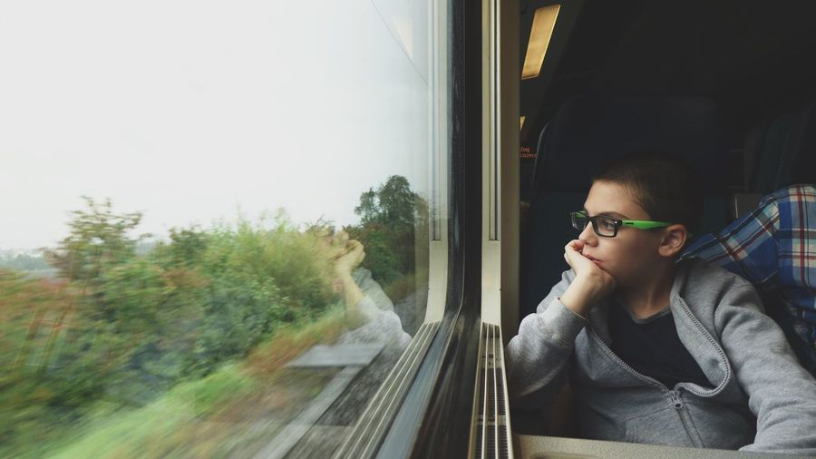 Boy Sitting In Train