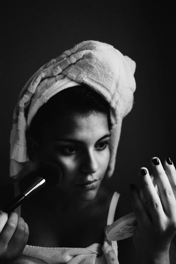 Woman Applying Make-Up With Brush
