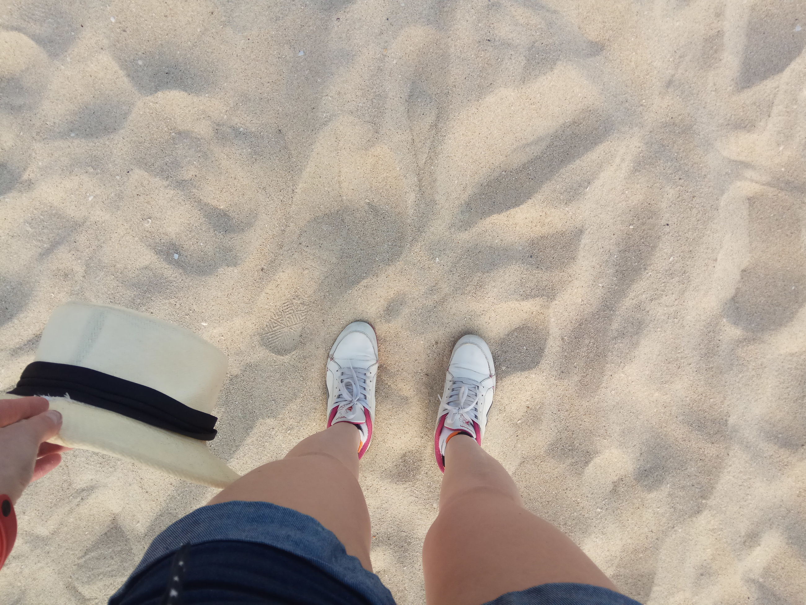low section, personal perspective, human leg, standing, sand, human body part, directly above, beach, one person, vacations, outdoors, one woman only, day, adults only, people, close-up, real people, adult