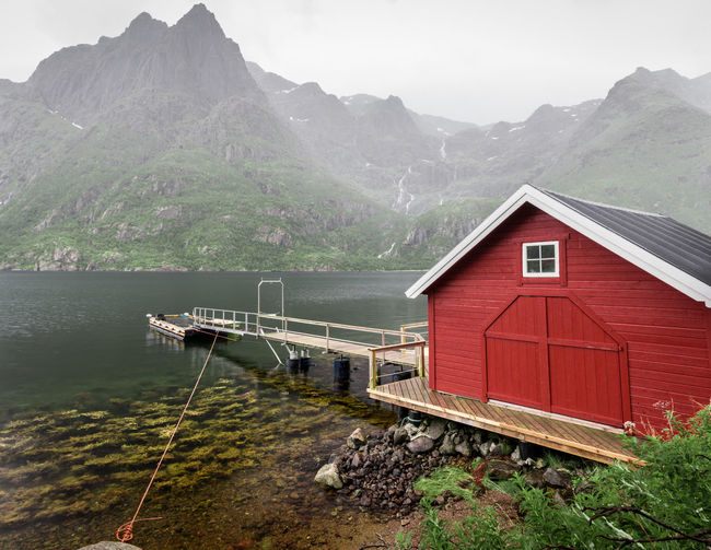 Amazing landscape from Lofoten - Norway Colors Moody Sky Norway Red Summer Views Boat House Colorful Fjord Fog House Island Landscape Lofoten Moody Mountain Mountain Range Mountains Svolvær Vacation Water Waterfall Waterfront