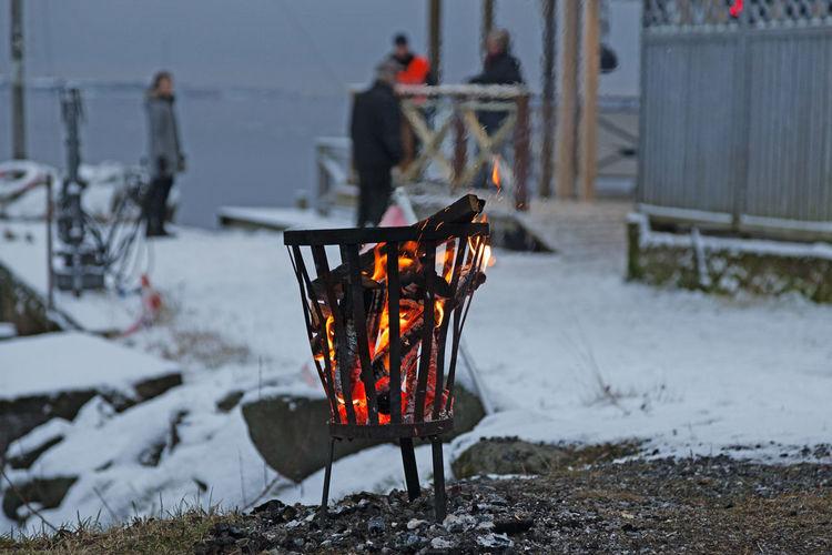 Open fire in basket outside saltery