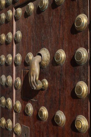 famous door knockers of Cadíz Cadiz Close-up Door Door Knocker Doorknob Fist Full Frame Gold Colored Hand Indoors  Metal Pattern Wood - Material Stories From The City