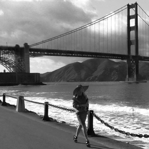 Rear view of man on bridge against sky
