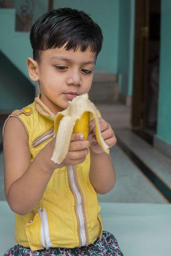 Full length of a boy holding ice cream