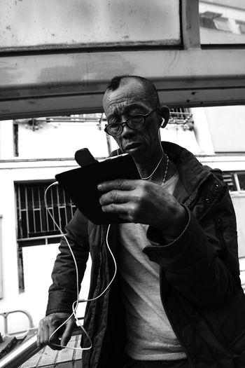 Full length of man holding camera