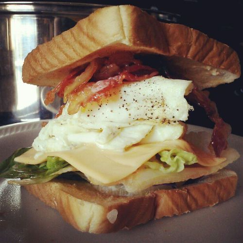 My future husband will never leave me. Bestbreakfeastsandwhich Ever Breakfeasttime Yummy southernstyle soitherncookin homemade baconeggandcheese crispybacon americancheese lettuce toast eggs easyover delicious mine bacon omg sogood countrycookin mmm wouldyoumarryme bestwaytoamansheart throughhisstomach haha takeabite