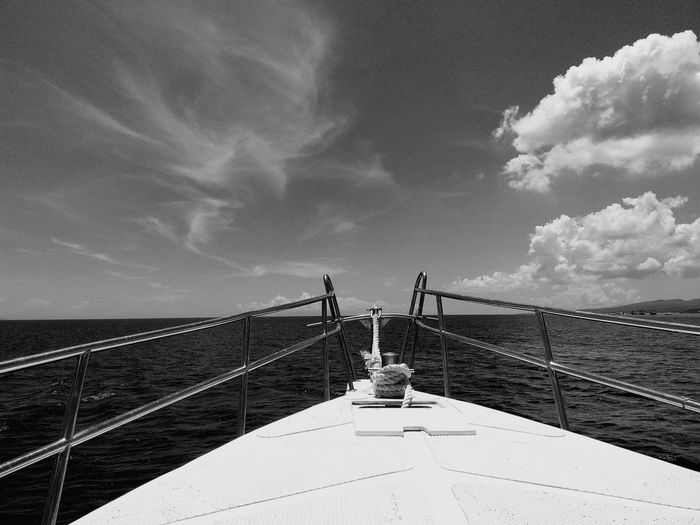 Boat at sea against sky