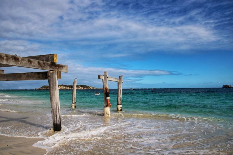 At the beach Water Sea Sky Beach Land Beauty In Nature Cloud - Sky Scenics - Nature Horizon Over Water Tranquil Scene Tranquility Day Wood - Material Outdoors Idyllic Wooden Post Architecture