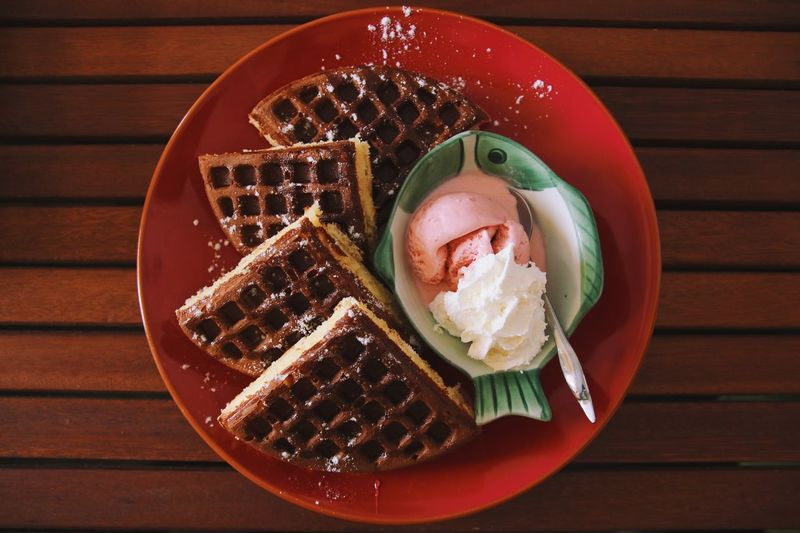Close-up of ice cream waffles in bowl on table