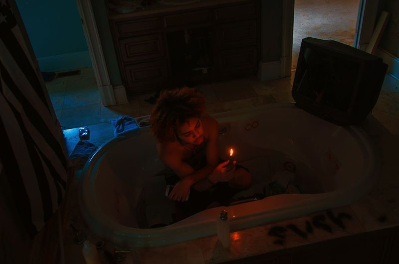 ALONE TIME #Musician #Support #musician Photo Shoot Atlanta Atlanta, Georgia #SquilloPierre Love Yourself Fire Candlelight Lighter Bathroom Bathtub Spirited Free Spirit Artist Male darkness and light Young Man Abandoned Buildings