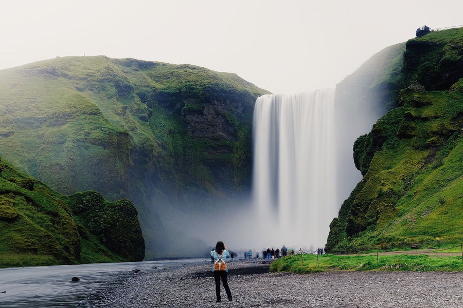 The land of fire and ice. Taken in Iceland, Skógafoss. Waterfall Water Motion One Person People Fujifilm_xseries Adventure Travel Outdoors Adult Scenics Travel Destinations FUJIFILM X-T10 Nature Day Beauty In Nature Vacations One Woman Only Iceland Sky Long Exposure Landscape EyeEm Selects Nature Fujifilm The Week On EyeEm