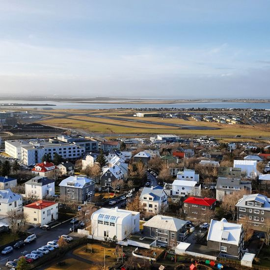 Reykjavik airport Airport Runway Reykjavik City Cityscape Sea Harbor Beach Town Business Finance And Industry Sky Horizon Over Water Building Exterior TOWNSCAPE Rooftop Housing Settlement Residential Structure Human Settlement Residential District