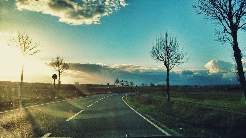 Driving Home Sun Light Clouds And Sky Street Green Light
