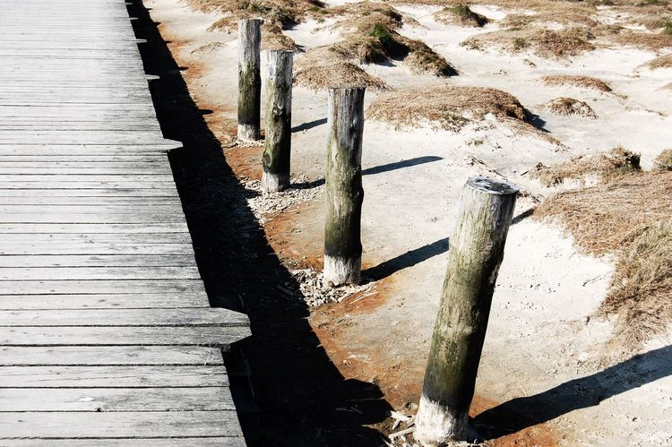Strandweg. Wood - Material St Peter Ording Day No People Outdoors Alone Time Light And Shadow Beauty In Nature Textures And Surfaces Close-up Detail Wood Planks Architectural Detail The Week On Eyem Beach Tranquil Scene