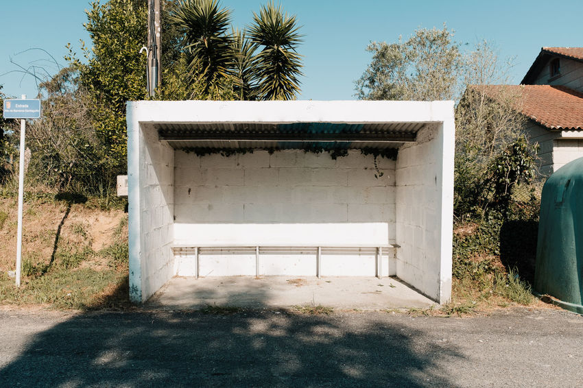 LOST IN GALICIA 🚌 Architecture Tree Built Structure Plant No People Day Nature Building Exterior Outdoors Land Bus Stop Lostingalicia Threeweeksgalicia Sunlight Sky Building House Shadow Growth Palm Tree Front Or Back Yard Tropical Climate Absence Garage