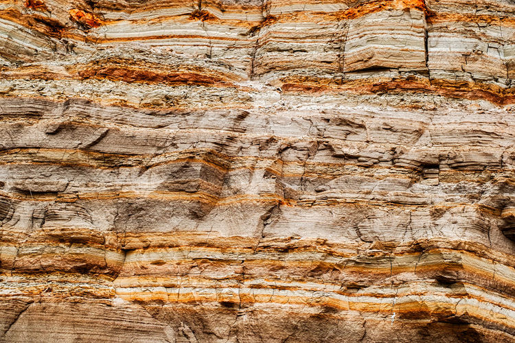different color layers of soil Different Color Layers Of Soil Full Frame Backgrounds Solid No People Rock - Object Rock History Ancient Pattern Textured  Nature Rock Formation Architecture Close-up Outdoors Day Brown Rough The Past Geology Layered Eroded