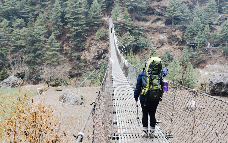 EBC Trek 2018 The Week on EyeEm Trekking Woman Activity Adventure Backpack Bridge - Man Made Structure Connection Day Forest Full Length Hiking Leisure Activity Lifestyles Motion Mountain Nature One Person Outdoors Outside Plant Real People Rope Tree