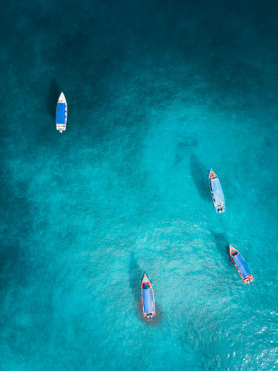 Aerial view of boat moored in sea